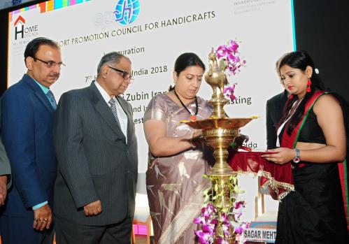 The Union Minister for Textiles and Information & Broadcasting, Smt. Smriti Irani lighting the lamp at the inauguration of the Home Expo India - 2018, at India Expo Centre and Mart, Greater Noida, in Uttar Pradesh on April 16, 2018.