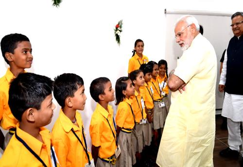 The Prime Minister, Shri Narendra Modi interacting with the school children, at the inauguration of the Integrated Command & Control Centre, at Naya Raipur, Chhattisgarh on June 14, 2018.