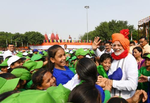 The Prime Minister, Shri Narendra Modi interacting with the school children after addressing the Nation on the occasion of 72nd Independence Day from the ramparts of Red Fort, in Delhi on August 15, 2018.