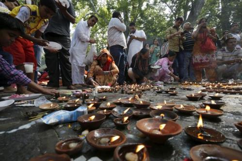 IMAGE: A file photograph of Kashmiri Pandits offering prayers at the Kheer Bhawani temple. Photograph: Umar Ganie