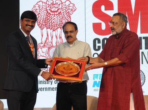 The Minister of State for Micro, Small & Medium Enterprises (I/C), Shri Giriraj Singh felicitating the India s Small Giants at the International SME convention 2018, in New Delhi on April 22, 2018. The Secretary, MSME, Shri Arun Kumar Panda is also seen.