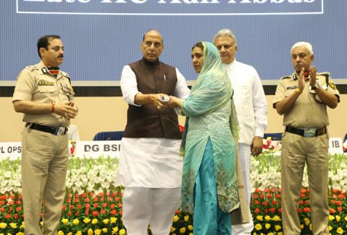 The Union Home Minister, Shri Rajnath Singh presenting the awards, at the Investiture Ceremony of Border Security Force (BSF), in New Delhi on May 22, 2018. The DG, BSF, Shri K.K. Sharma and the Director, IB, Shri Rajiv Jain are also seen.