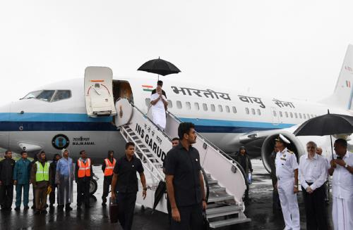 The Prime Minister, Shri Narendra Modi being received by the Governor of Kerala, Justice (Retd.) P. Sathasivam and the Chief Minister of Kerala, Shri Pinarayi Vijayan, on his arrival, in Kochi, to survey the flood affected areas, on August 18, 2018.