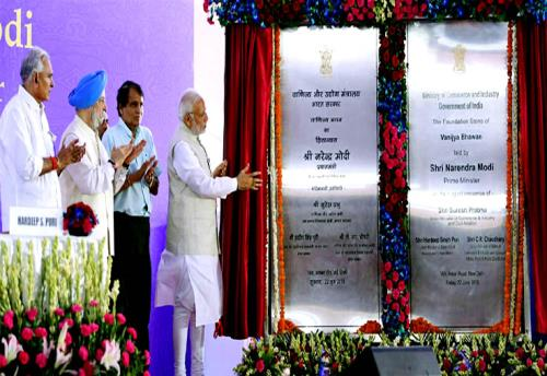The Prime Minister, Shri Narendra Modi unveiling a plaque to mark the laying of foundation stone of Vanijya Bhawan, at Akbar Road, in New Delhi on June 22, 2018