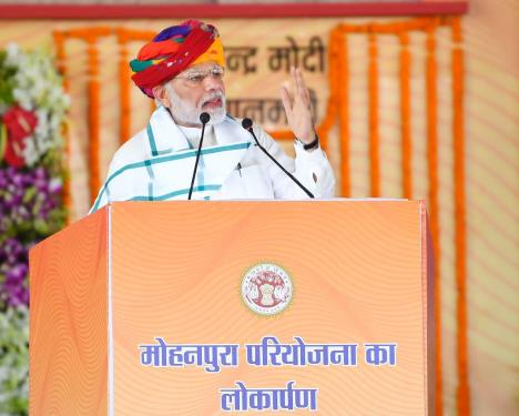 The Prime Minister, Shri Narendra Modi addressing the gathering at the dedication ceremony of the Mohanpura Project to the Nation, in Madhya Pradesh on June 23, 2018.