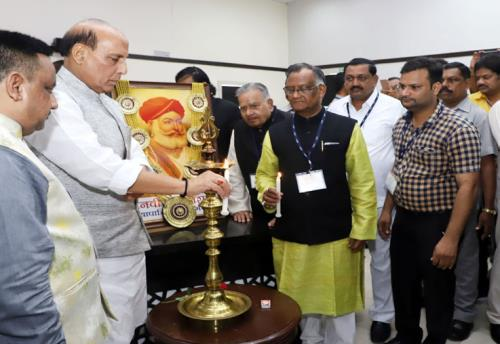 The Union Home Minister, Shri Rajnath Singh lighting the lamp to inaugurate the Confederation of All India Traders' National Conclave, in New Delhi on July 23, 2018.